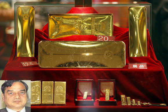Gold bars of various sizes on display at Beijing's biggest gold store. DK Mittal, inset.