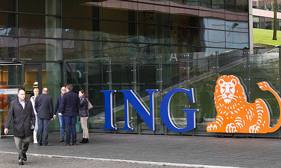 Employees of ING group take a break in front of their office in Amsterdam, the Netherlands.