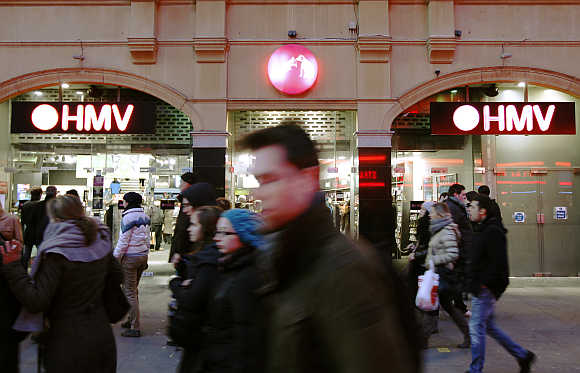 People walk past a HMV store branch in London.