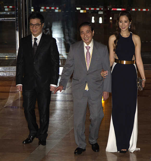 Lee Shau Kee, centre, with his son Martin Lee Ka-shing and his wife Cathy Chui in Hong Kong.
