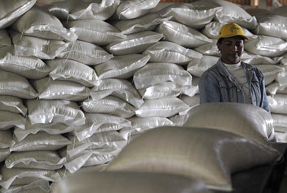 A worker examines sacks of sugar at a Cuban factory in Calimete.