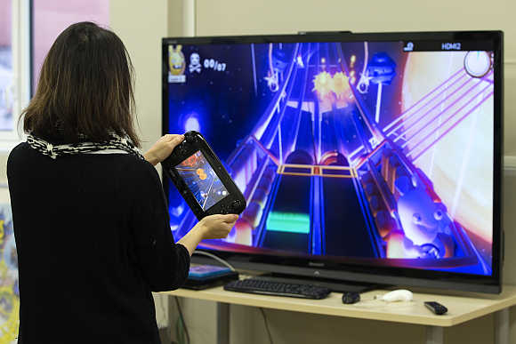 A woman plays a video game in Montreuil-sous-Bois, near Paris.