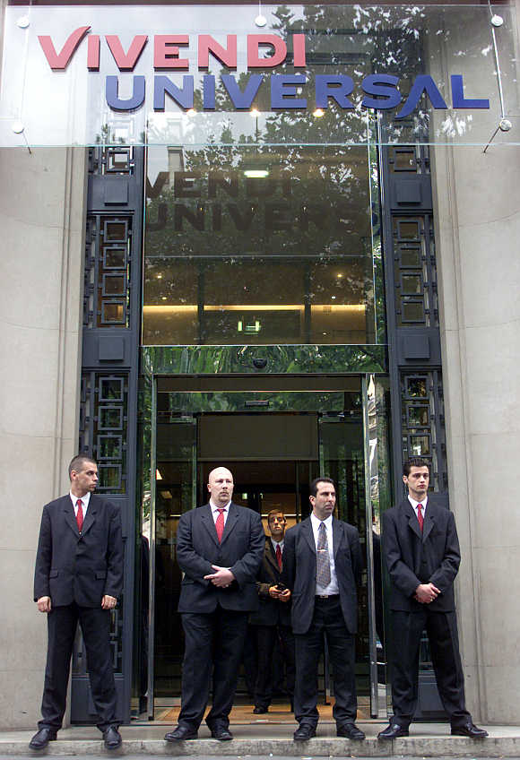 Vivendi members of security stand in front of Vivendi Universal headquarters in Paris.