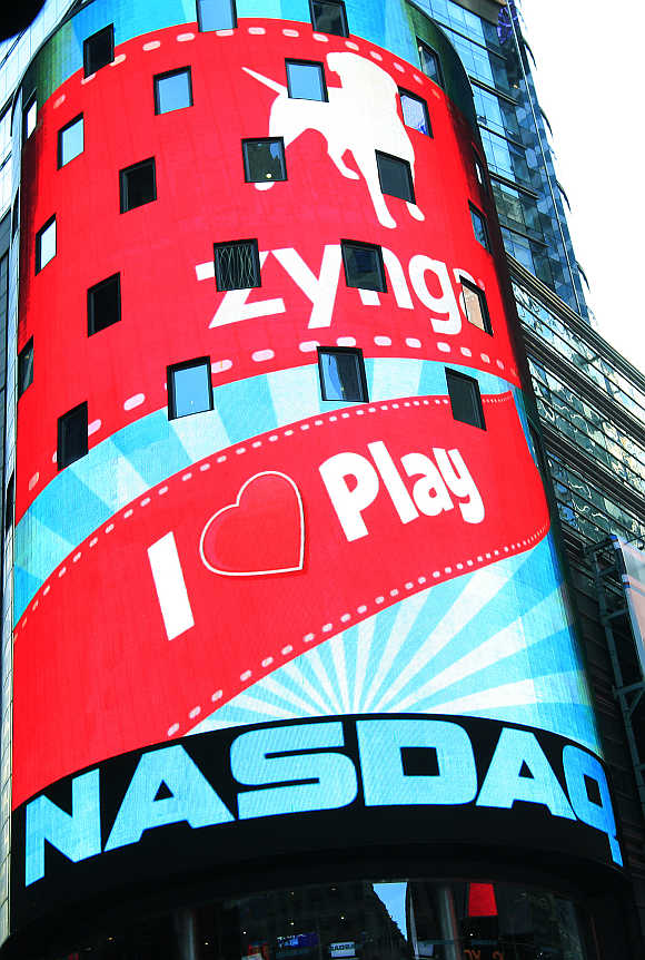 Corporate logo for Zynga on the board outside the Nasdaq Market Site in New York's Times Square.