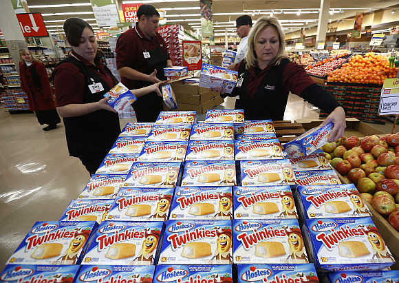 Workers unpack shipment of Twinkies at a Jewel-Osco grocery store in Chicago. Hostess owns Twinkies.