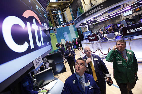 Traders at the post that trades Citigroup stock on the floor of the New York Stock Exchange.