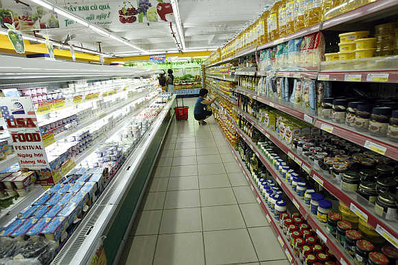 A woman shops at Fivimart supermarket in Hanoi, Vietnam.
