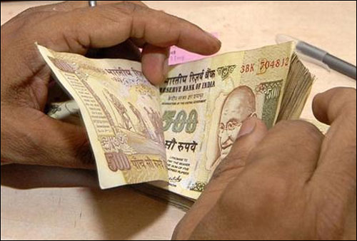 Rupee gains 17 paise against dollar in early trade