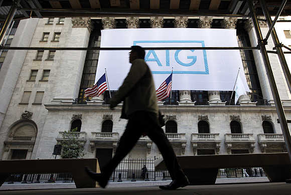 American International Group's banner hangs on the facade of the New York Stock Exchange.