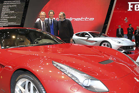 Ferrari CEO Luca Cordero di Montezemolo, Fiat Chairman John Elkann, and Fiat-Chrysler CEO Sergio Marchionne with Ferrari F12 Berlinetta in Geneva.