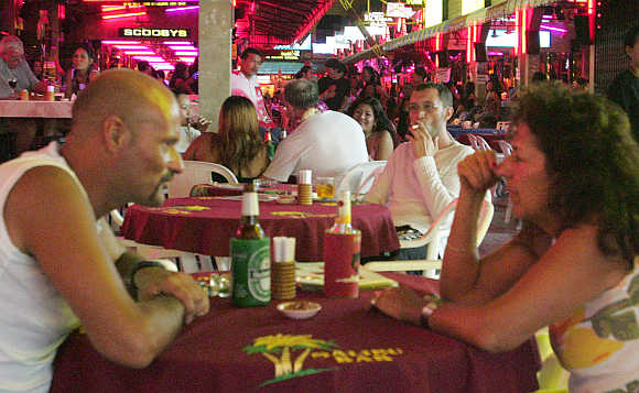 Foreign tourists in a bar in Patong Beach, Phuket.