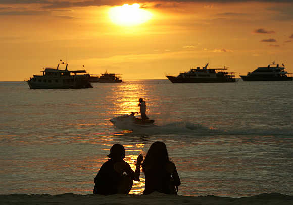 Sun sets on Patong Beach in Phuket.