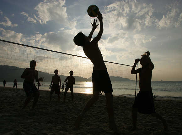 French children play volleyball on Patong Beach in Phuket.
