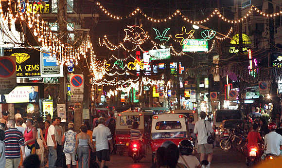 Tourists enjoy the nightlife in Phuket.