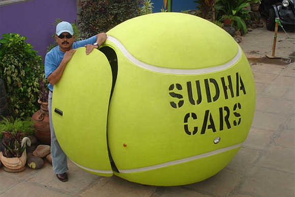 A tennis ball-shaped car in the museum.