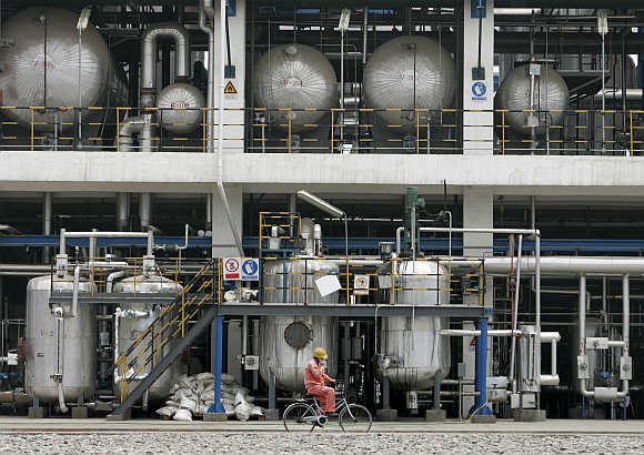 A worker cycles inside CNPC Lanzhou Chemical Company in Lanzhou, China.