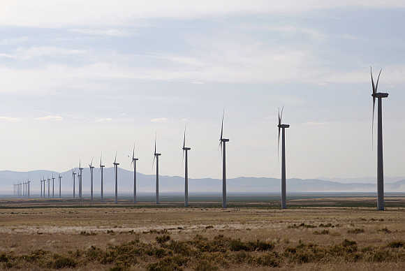 Wind turbines operate at a wind farm near Milford, Utah.