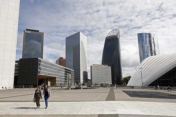 A view of French oil engineering group Technip tower, left, French group GDF Suez headquarters tower building, second right, and mobile operator SFR tower, right, at the La Defense business district, near Paris.