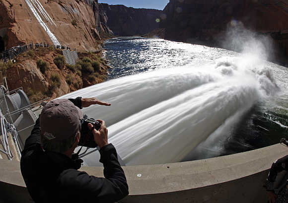 A photographer takes pictures at the Glen Canyon Dam in Page, Arizona, United States.