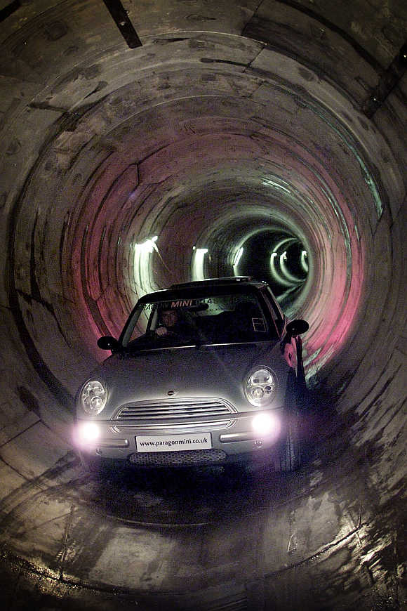 Yorkshire Water project manager Steve Tindall drives a BMW mini cooper through a sewer system under the streets of Hull, United Kingdom.