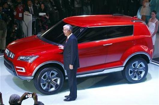 Shinzo Nakanishi, chief executive and managing director of Maruti Suzuki, poses with company's new compact SUV XA Alpha.