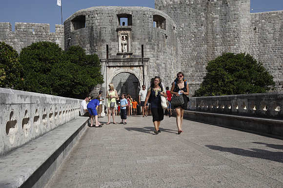 Tourists walk out of Old Town in Dubrovnik.