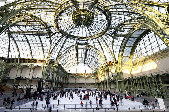 Skaters enjoy the ice on a giant ice rink at the Grand Palais exhibition hall in Paris.
