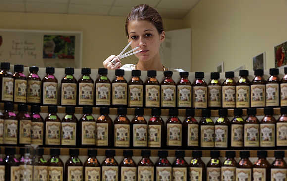 Caroline De Boutiny, perfume creator, holds paper scent testers as she smells different essences in Grasse, France.