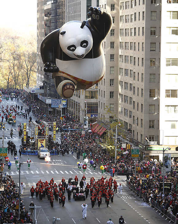 A Kung Fu Panda balloon float makes its way down Sixth Avenue during the Macy's Thanksgiving Day Parade in New York.