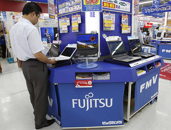 A man takes a look at Fujitsu's laptop at an electronics store in Tokyo.