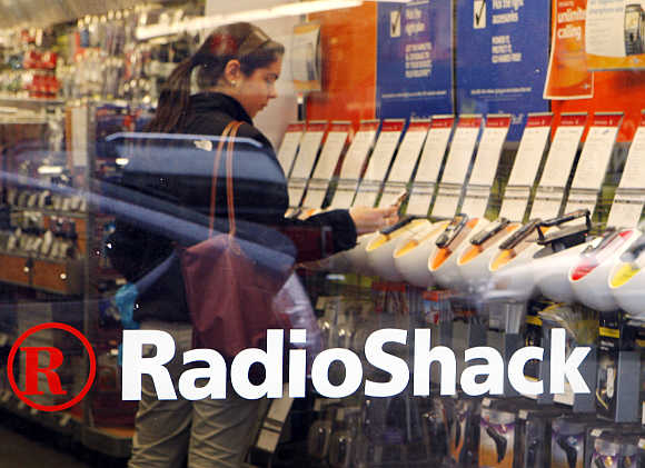 A shopper looks over mobile phones displayed at a Radio Shack store in Cambridge, Massachusetts.