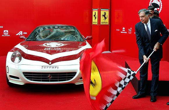 Ratan Tata flags off a Ferrari 612 Scaglietti on the Magic India Discovery tour in Mumbai.