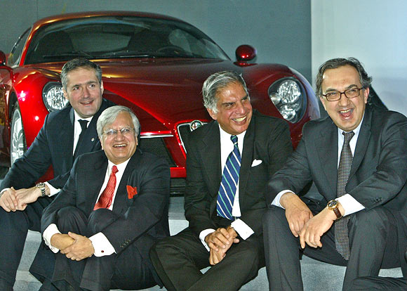 Sergio Marchionne, right, Fiat chief executive, Ratan Tata, second right, Ravi Kant, second left, then managing director, Tata Motors, and Alfredo Altavilla, then CEO, Tofas, after unveiling a Fiat car at the 8th Auto Expo in New Delhi.