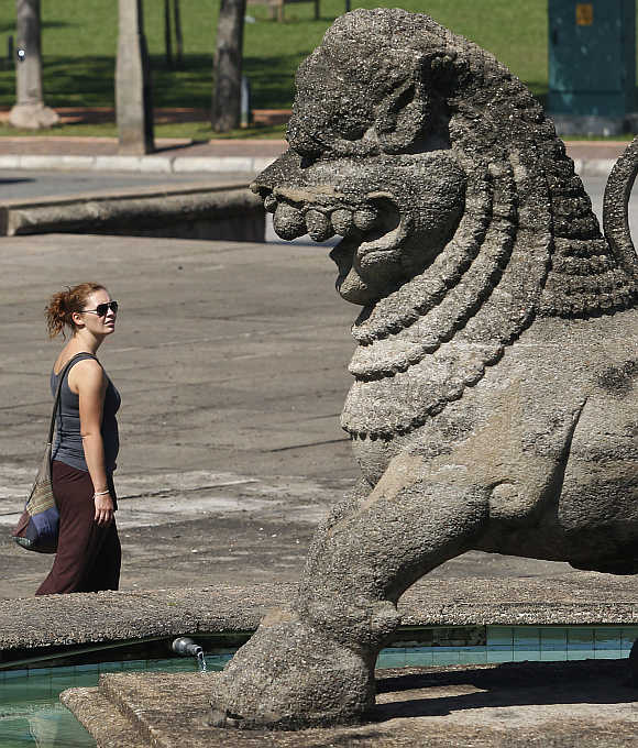 A tourist at Sri Lanka's Independence Square in Colombo.