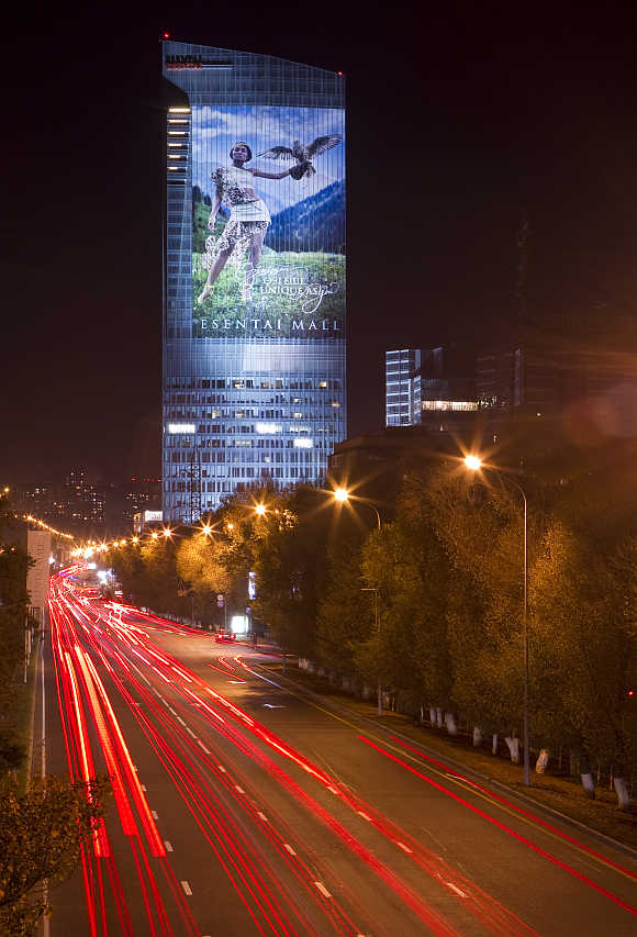 Traffic moves past Esentai Tower along Al Farabi Avenue in Almaty.