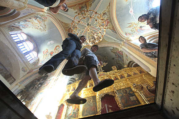 People look down at a crypt museum at Saint George Orthodox Cathedral in Beirut.