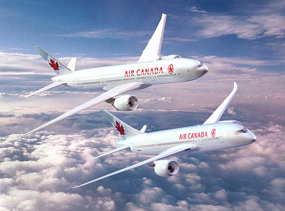 Boeing 777, top, and 787 Dreamliner are seen in this photograph from Air Canada.