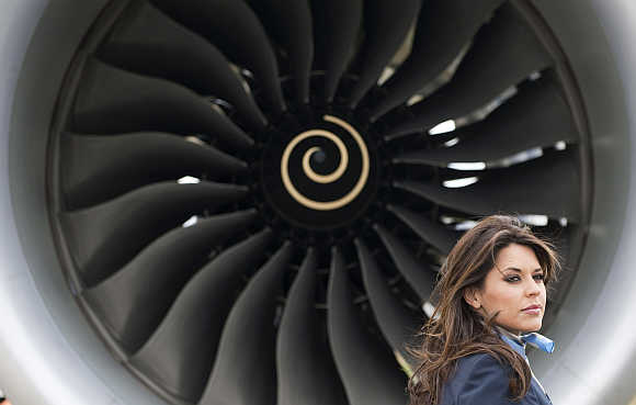 Model Daniella Lineker stands in front of the Boeing 787 Dreamliner aircraft at Farnborough airport in Farnborough, southern England.