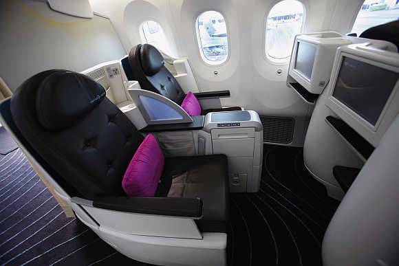 View of business-class cabin seats during media tour of Boeing 787 Dreamliner in Singapore.
