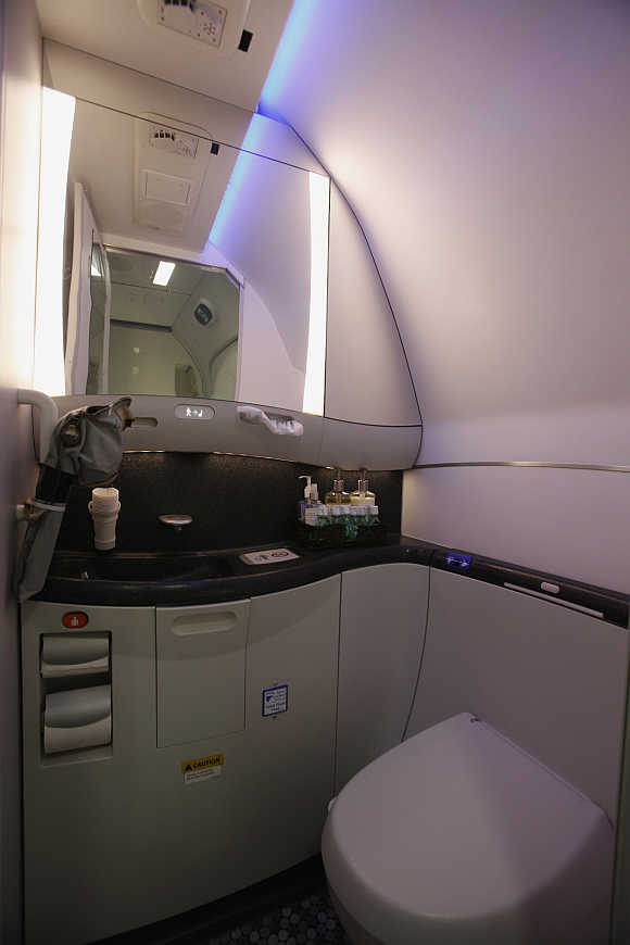 Washroom of Boeing 787 Dreamliner is lit up with LED lighting during demonstration flight of aircraft at Singapore Airshow in Singapore.