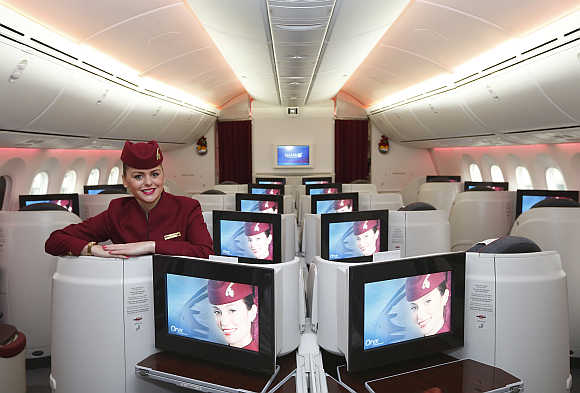 A flight attendant in the business-class cabin of the Boeing 787 Dreamliner at Heathrow Airport, west London.