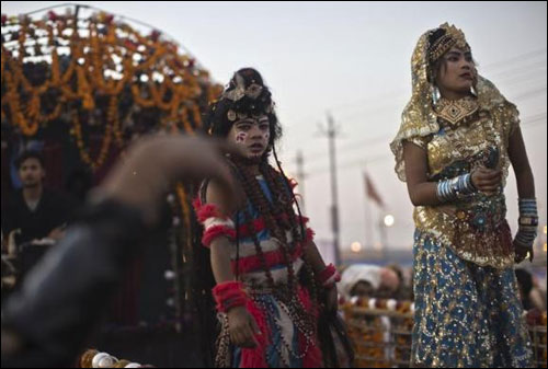 Artists dressed as Hindu deities take part in a religious procession.