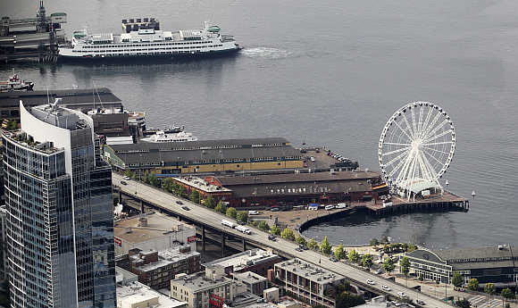 Aerial view of the Seattle Great Wheel and a Washington State ferry boat on the Elliott Bay waterfront in Seattle.