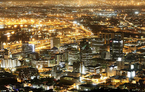Cape Town's business district lights up as dusk falls over the city.