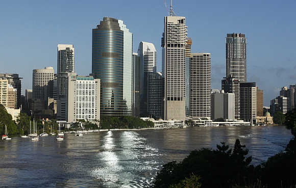 Brisbane River is seen flowing past the skyline of central Brisbane.
