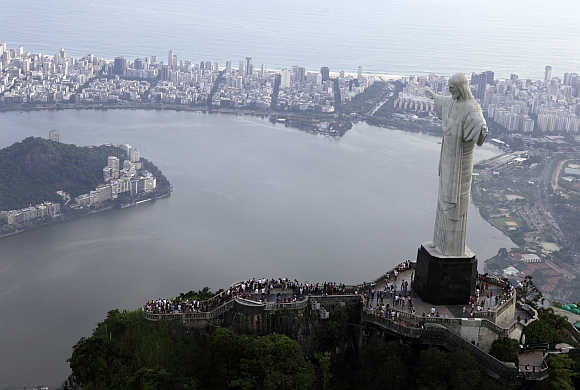 An aerial view of the famous Christ the Redeemer atop of Corcovado mountain in Rio de Janeiro.