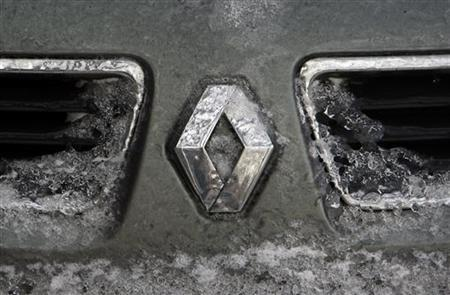 The logo of French car manufacturer Renault is seen on the bonnet of a vehicle covered with snow and ice in Bucharest.