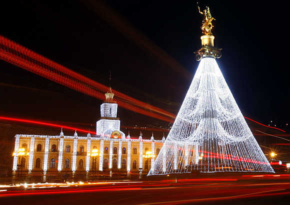 City Hall and the Freedom Monument are illuminated with Christmas decorations on the main square in Tbilisi, Georgia.