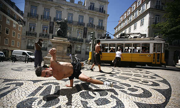 Alan Silva, 24, dances in downtown Lisbon, Portugal.