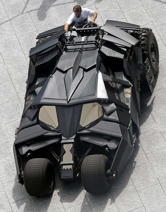 A workman polishes The Tumbler Batmobile during a promotional stop in downtown Toronto, Canada.